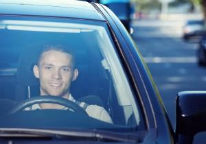 Young man driving car