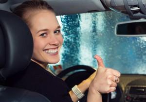 girl in car happy
