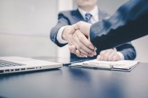 Business Man. Business handshake and business people vintage tone. Business shake hand. Business woman. Business working. Business room. Business office.