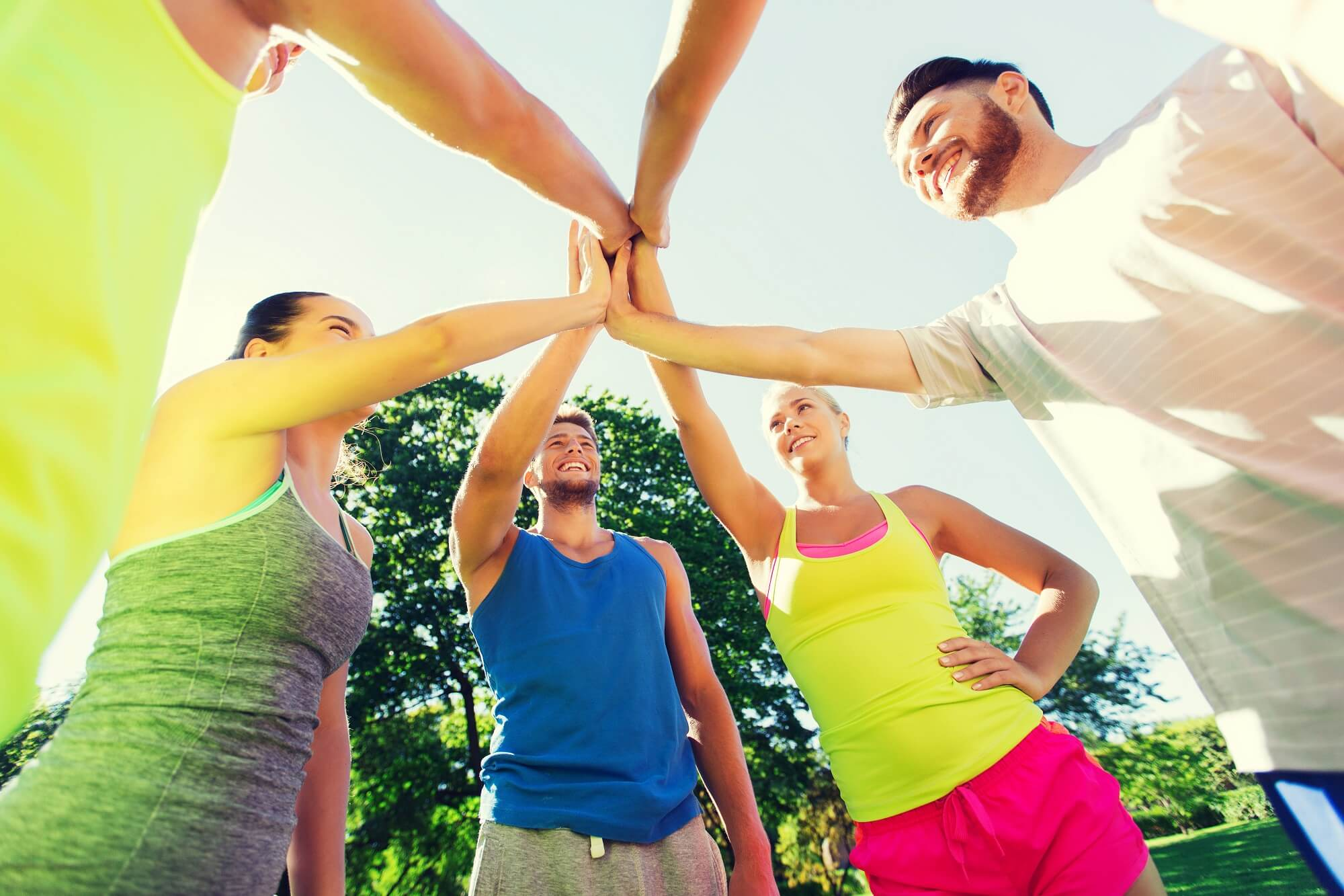 fitness, sport, friendship and healthy lifestyle concept - group