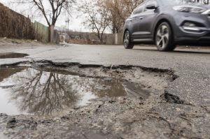 Pot Hole - Car Damage