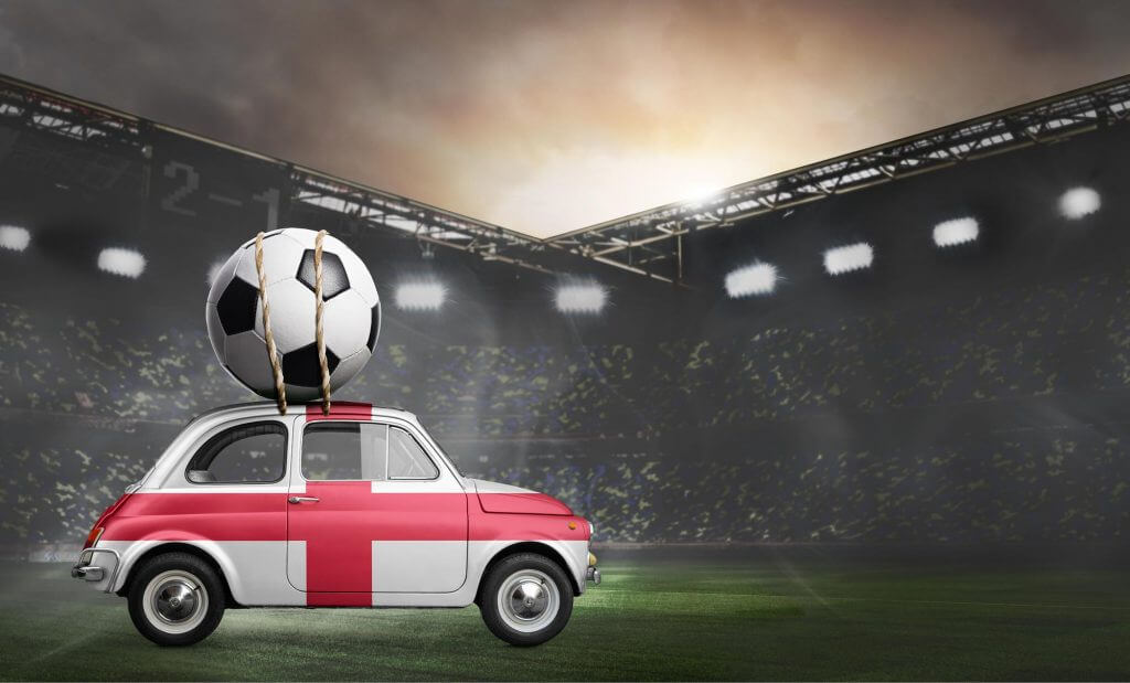 england car delivering football to stadium