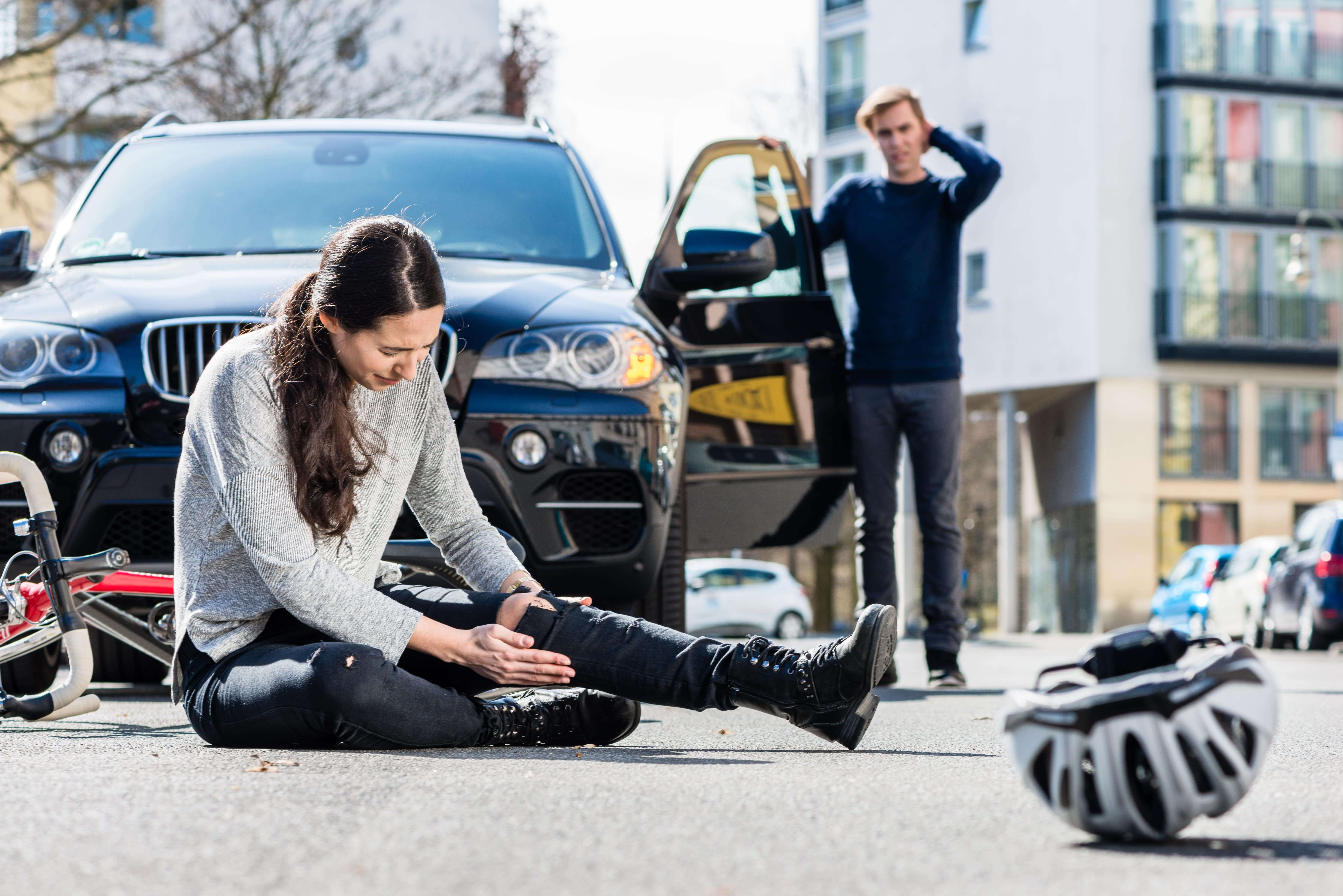 Car accident, woman knocked off bike
