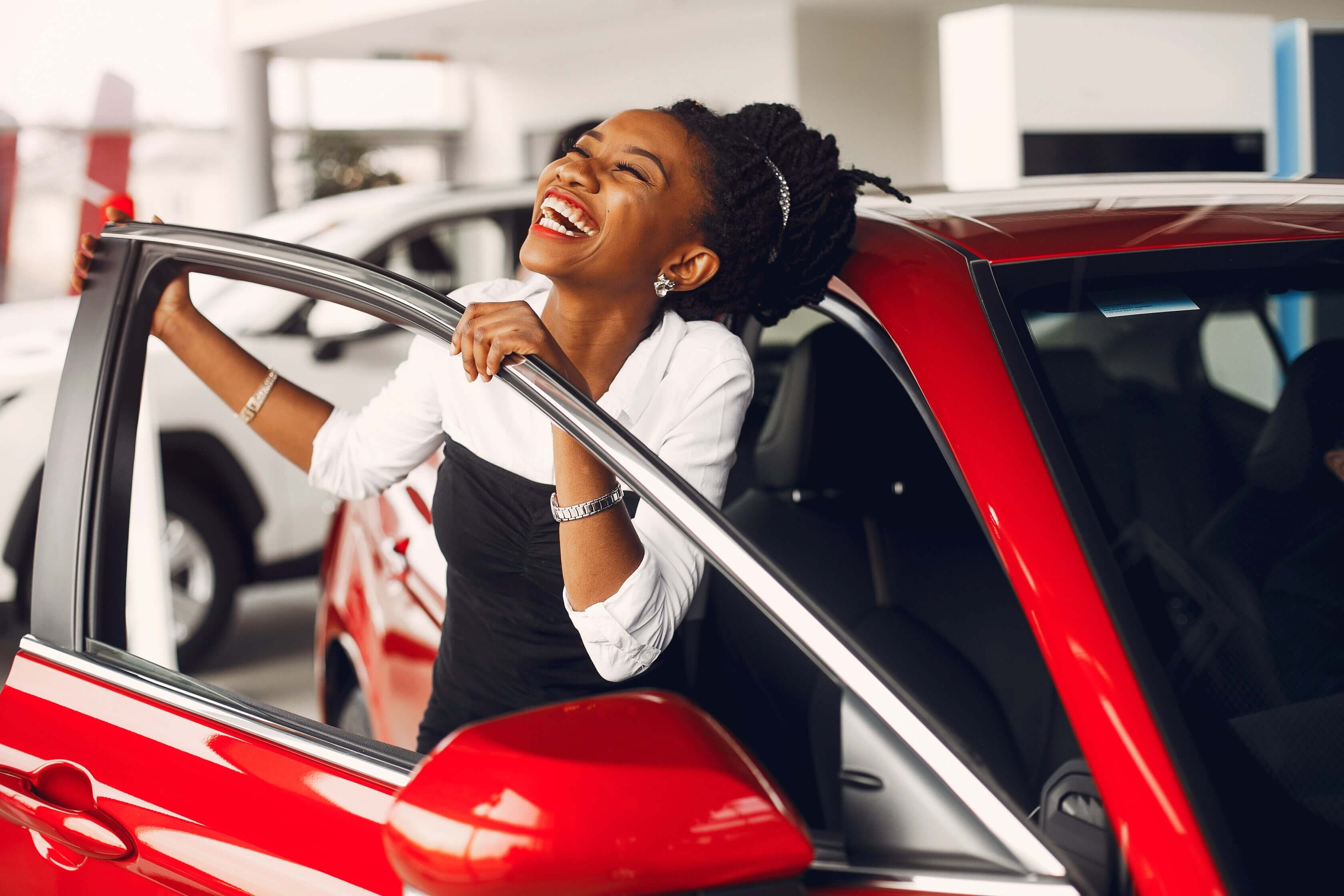 Excited woman in new car