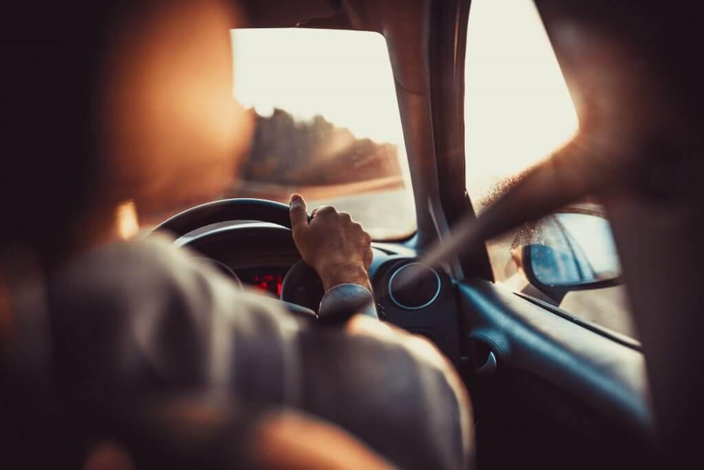 driving_in_sunset_over_shoulder